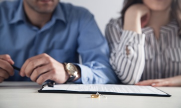 A Couple Looking at Collaborative Divorce Paperwork