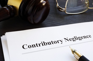 Contributory Negligence Paperwork and Gavel