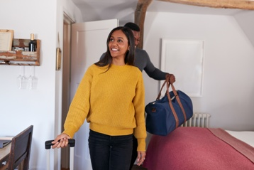 Couple Arriving at an Airbnb