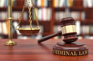 Criminal Law Wooden Gavel and Scales of Justice