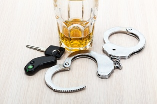Car Keys, Alcoholic Drink, and Handcuffs