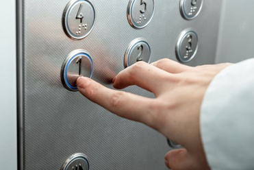 Pressing Buttons on an Elevator