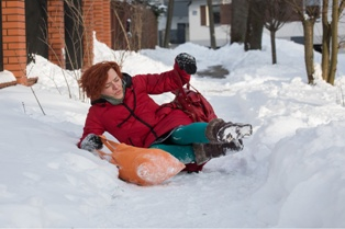 Woman Falling on a Snowy Sidewalk