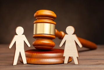 Family Cutouts With a Wooden Gavel
