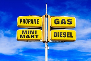Gas Station Sign With a Mini Mart and Propane Sales Sign