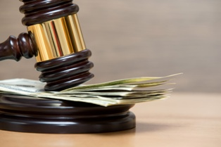 Gavel With Money for Punitive Damages