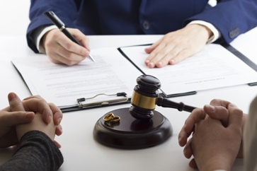 Gavel With Wedding Rings and Paperwork