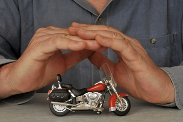 Hands Protecting a Motorcycle