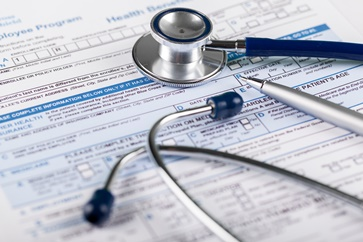 Health Benefits Paperwork and Stethoscope