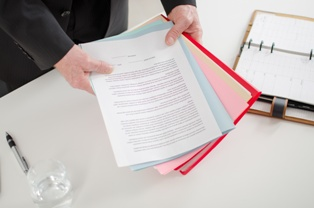Car Accident Attorney Reviewing Important Documents at an Initial Meeting