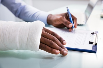 Injured Man Signing Paperwork
