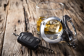 Alcohol, Handcuffs, and Car Keys Used in a DUI Involuntary Manslaughter Case