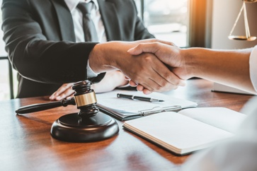 Lawyer Shaking the Hand of a Potential Client During a Consultation