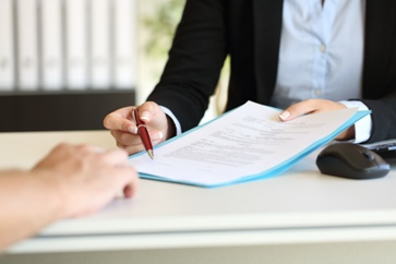 Lawyer Explaining Paperwork to a Potential Client