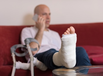Injured Man Talking to Lawyer on Phone