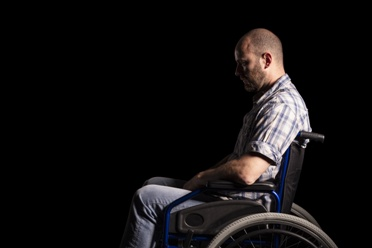 Man in Wheelchair With Permanent Injuries