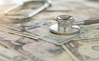 Money and Stethoscope for Future Medical Expenses