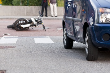 Debris in the Road From a Car and Motorcycle Collision