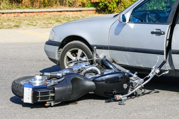 Motorcycle and Car Wreckage in the Middle of an Intersection