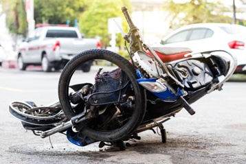 Crumpled Motorcycle Debris After a Serious Wreck