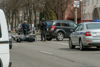 Scene of a Motorcycle Wreck With Various Emergency Vehicles