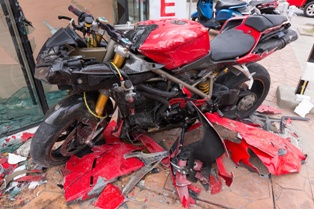 The Remnants of a Motorcycle After an Wreck Caused by a Car Driver