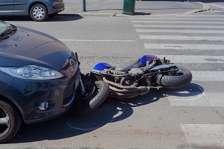 The Scene of a Motorcycle Wreck at an Intersection