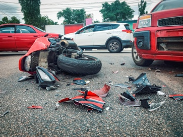 Motorcycle Wreckage Amongst Numerous Cars