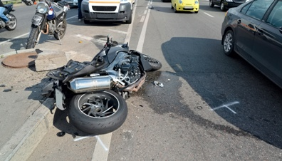 Motorcycle Wreckage in the Road After a Serious Accident