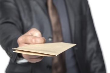 Insurance Adjuster Offering Settlement Paperwork