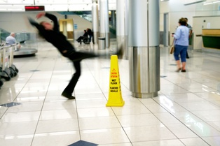 Man Slipping and Falling in an Airport