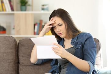Woman Reading a Claim Denial