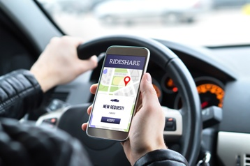 Driver Using a Rideshare App on His Phone