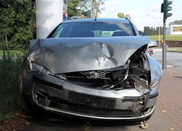Smashed Front-End of a Car After a Wreck