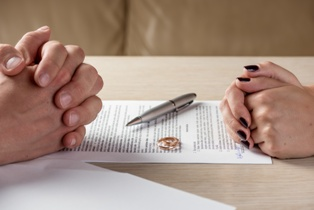 Divorcing Spouses Working on Paperwork