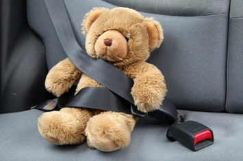 Child's Teddy Bear in the Back Seat of a Car
