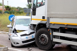 The Scene of a Collision With a Truck and Passenger Vehicle