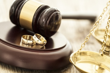 Wedding Rings by a Gavel and Scales of Justice
