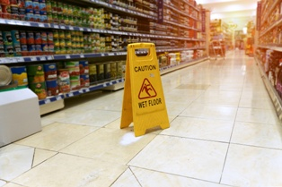 Wet Floor Sign in a Grocery Store Aisle