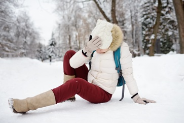 Woman Holding Her Head After a Slip and Fall on Ice