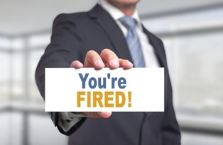 Client Holding a You're Fired! Sign