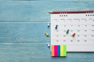 Calendar With Thumb Tacks Marking Important Days in a SSDI Claim