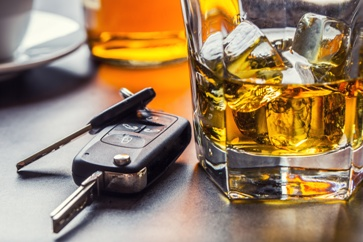 Car Keys by a Glass of Alcohol