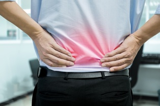 Company Employee With Serious Back Pain