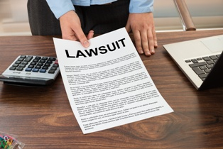 Lawyer Presenting Lawsuit Paperwork to a Client