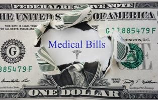 Medical Bills in a Torn up Dollar Bill