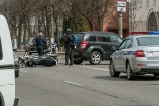 Serious Motorcycle Wreck Involving a Motorcycle and Car