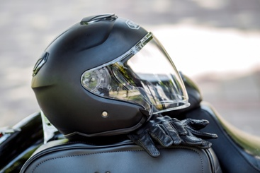 Motorcycle Helmet and Gloves on a Motorcycle