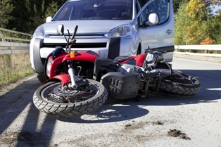 Motorcycle and SUV Wreckage After a Collision