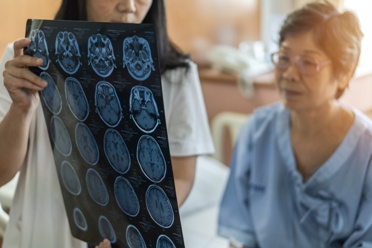 Patient With a Neurological Condition Looking at Scans